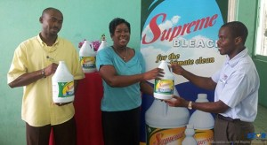Staff from the BTC receive Supreme bleach from Renwick & Company representative Decosta Pierre.
