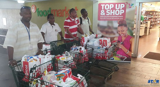 Some members of the local media got to try their hands at a one minute supermarket sweep courtesy  of DIGICEL.