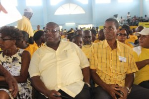 A jolly looking Stephenson King, with Egbert Andrew, sat with constituency delegates at the UWP convention last Sunday.