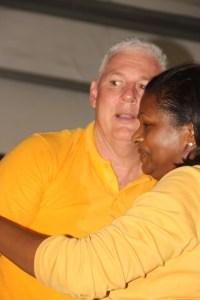 Allen Chastanet and Sarah Flood-Beaubrun embrace.