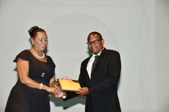 Mr Haydn Gittens, Bank of Saint Lucia Ltd, accepting the award.