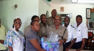 Miss RSLPF and Allied Services along with Acting PC Errol Alexander and other lawmen making a special contribution to a retired police officer.