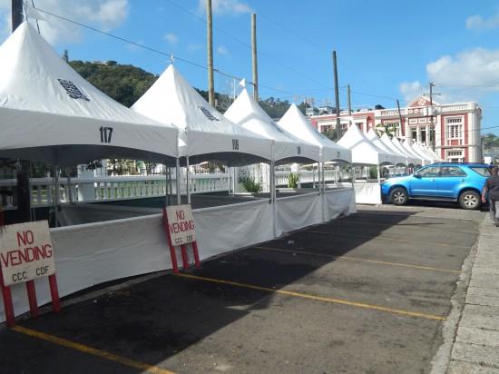 The pristine white tents aligning the Derek Walcott Square walls.