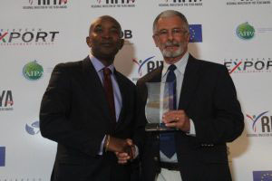 L-R: CAIPA President and ISL CEO McHale Andrew with Dunstan Du Boulay, Managing Director of Du Boulay's Bottling Company Ltd. receiving the award for Local Investor of the Year 2015.