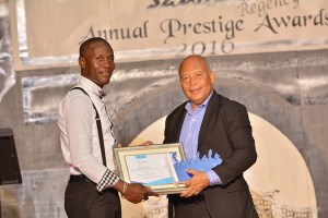 Platinum Talent of the Year Jonathan Sydney Receives his award from General Manager for Sandals Grande Mr. Winston Anderson