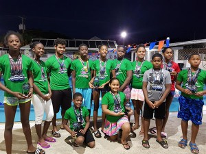 LA Swimmers with their trophies and medals from the Karen Beaubrun Meet