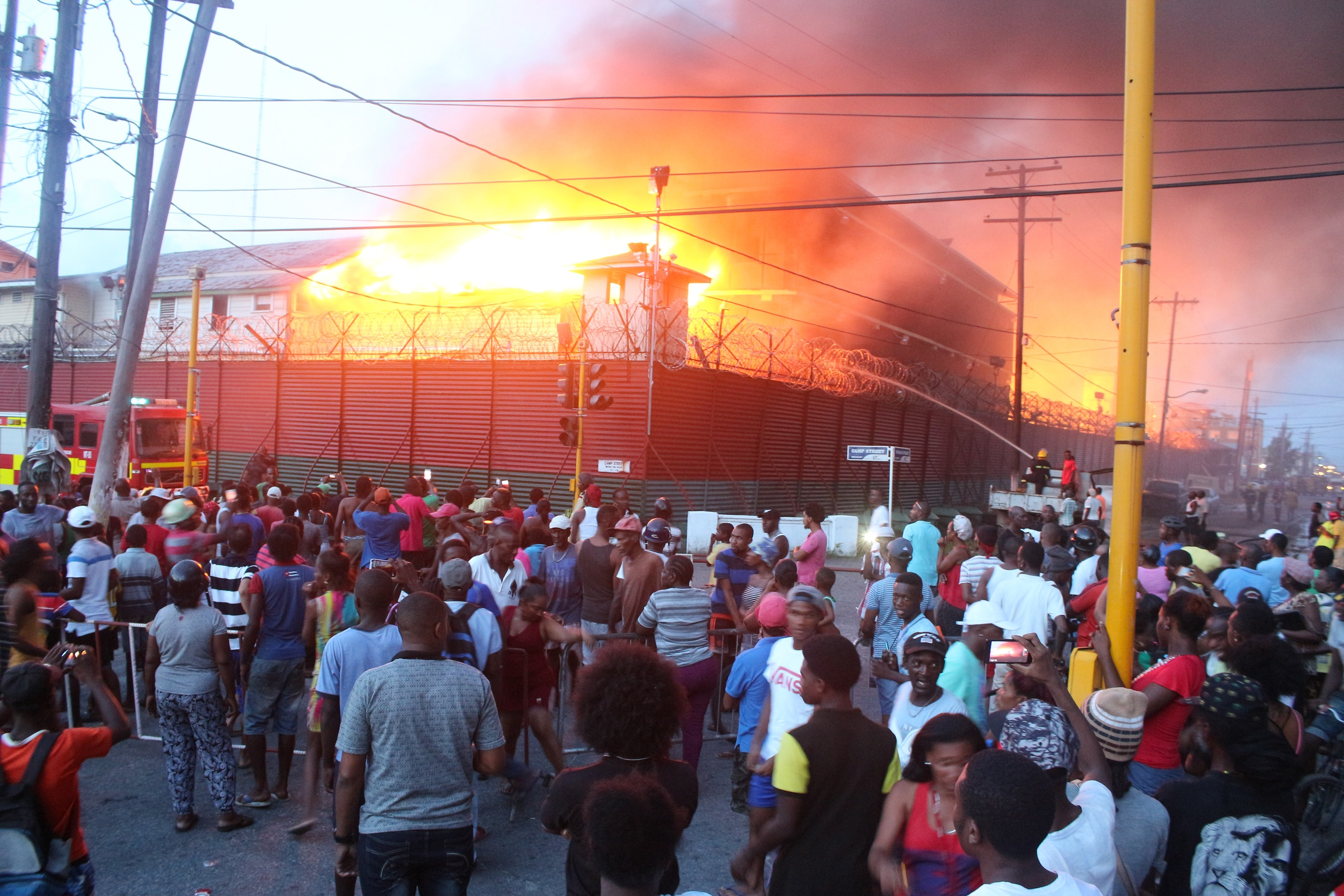 Inmates set Guyana prison ablaze, one officer dead after riot