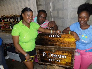 Shernelle Mc Donald (left) with her prized treasure of El Dorado Rum