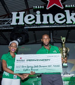The 2017 Heineken Green Synergy Winner XFactor receiving his check from WLBL Junio Brand Manager- Global Brands Mindy Luquiana Chicot