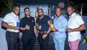 Ed Mathurin and Collin Brown (Left) with PCD brand managers and Marketing manager Dexter Percil (right)