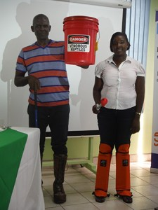 Forestry officials - Jeanette Victor and Pius Haynes display equipment and gears