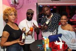 (From Left) Bar co-owner Ericka Emmanuel, Bunji Garlin, co-owner De Cherry and Campari Commercial Manager Michelle Brown stand outside the Campari Sponsored Dream Lounge in Gros Islet