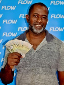 SALCC farm manager Lench Fevrier from Mon Repos, Micoud, a proud Flow customer and a $2000 cash winner!