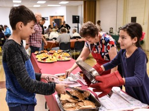 Youth serving pancakes on Easter Sunday