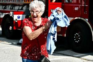 Mim Stunkard of St. Mark's holding her T-shirt