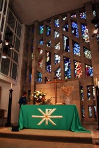 The church altar and east window at harvest