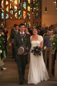 A newly-wed couple process down the aisle