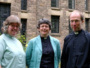 Shan, Sue and Ian standing on the bank outside the chapel windows