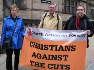 St Mark's members hold up a 'Christians against the cuts' banner outside Sheffield Town Hall