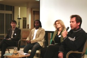 A panel take questions at a CRC conference