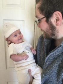 Man holding a baby