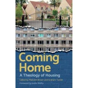 Book cover image showing gated estate and block of flats - Coming home, a theology of housing