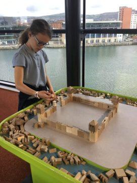 Aine building a castle