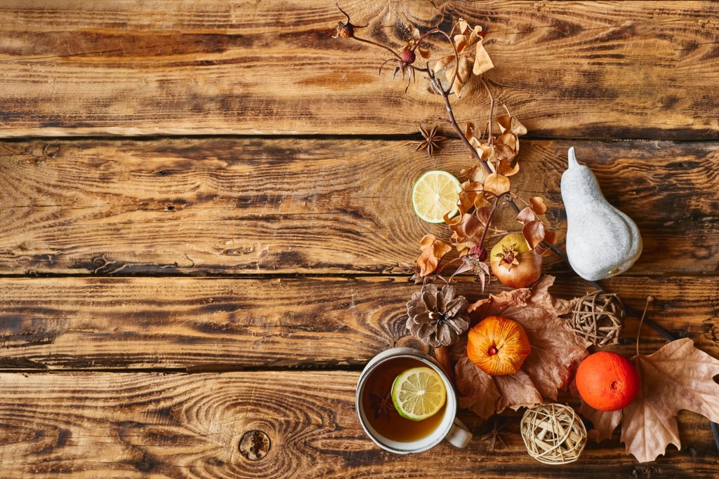 autumn-flat-lay-cup-of-lemon-hot-tea-and-star-anise-pumpkin-and-another-colorful-fall-fruits-and_t20_2KaAWP