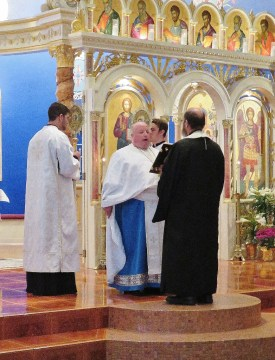Father Gary proclaims the Gospel from St. John