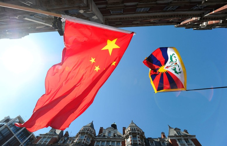 The People's Republic of China Flag alongside the Central Tibet Administration's Flag Courtesy of Google Images