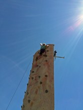 Mastering the climbing wall at Highland Fest