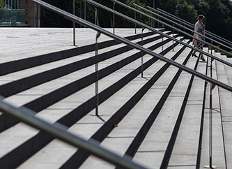 Street scene of woman descending stairs
