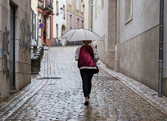 Woman with umbrella in downtown Luxembourg city