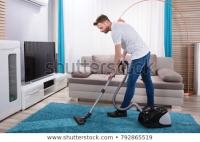 Living room cleaning vacuum cleaner, a young man. stock ...