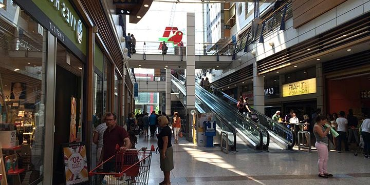 people shopping in commercial centre free stock image