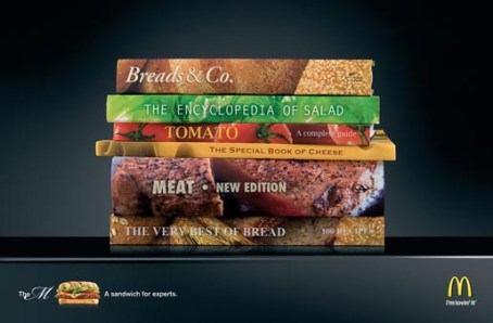 "creative agency DDB was set forth to help promote McDonald's latest menu in Hungary. Within the ad, a stack of books is placed accordingly to create a visual display of a burger. At the very bottom, a short sentence reads, ""The M: A sandwich for experts."" A creative, new gourmet twist on the famous American food chain and the perception of its burgers."