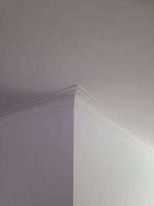 After picture of a crown molding plaster repair