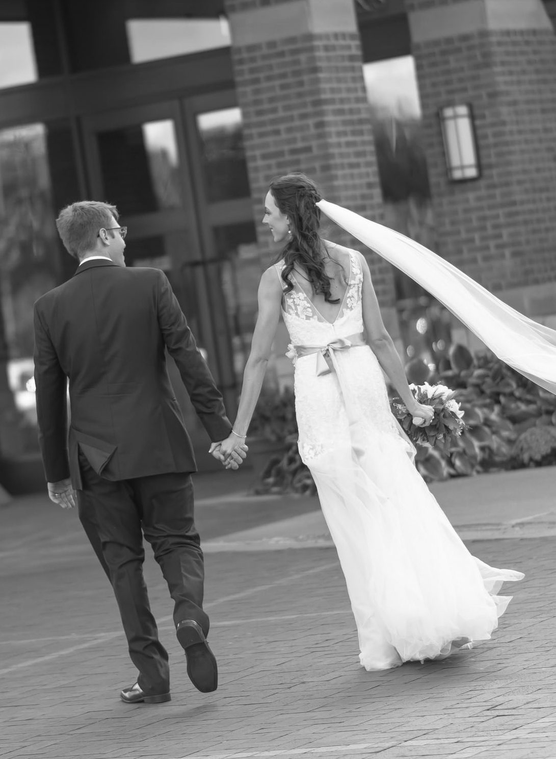 Bride And Groom Walking Hand-In-Hand
