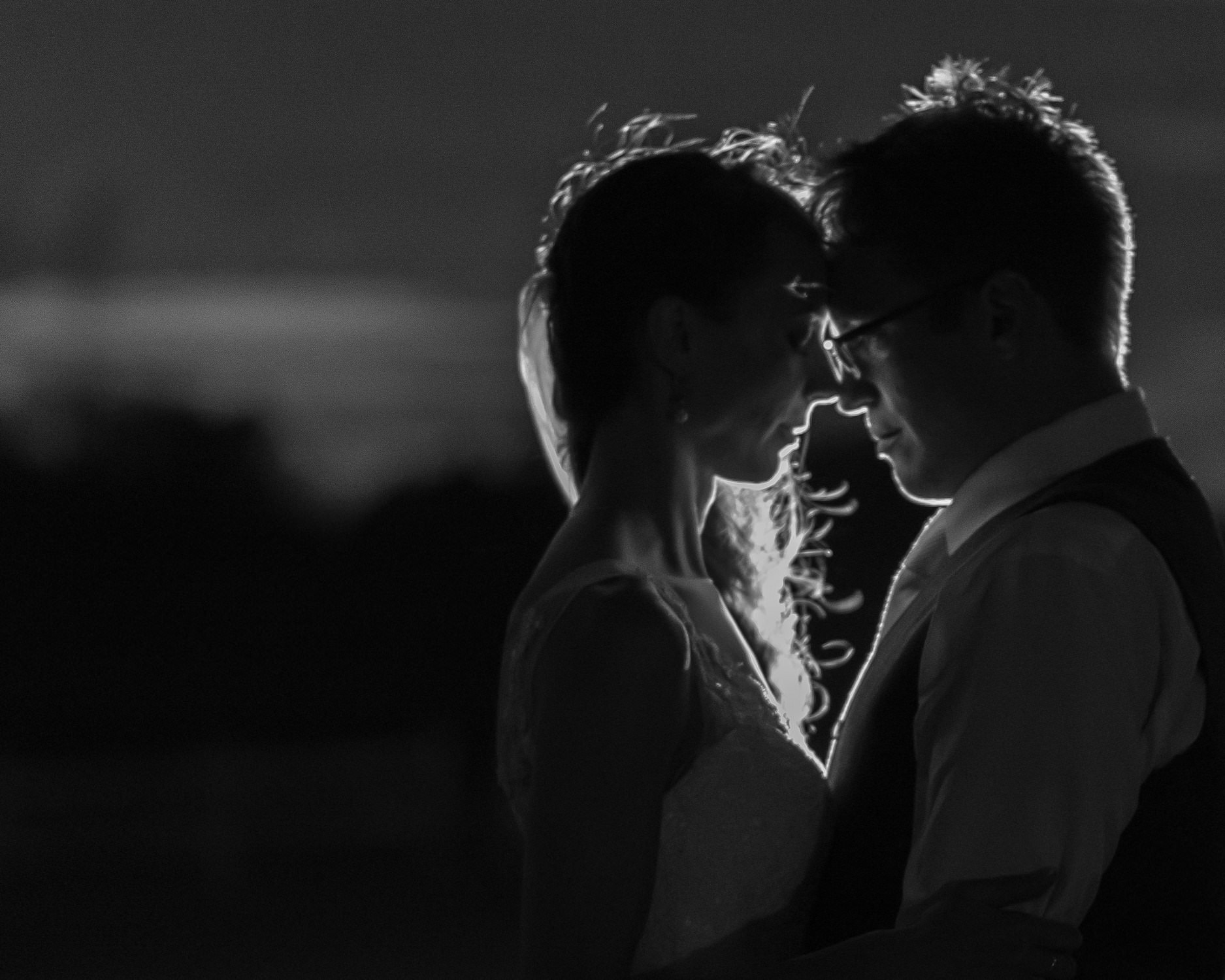 Bride And Groom In Heart-Shaped Backlight