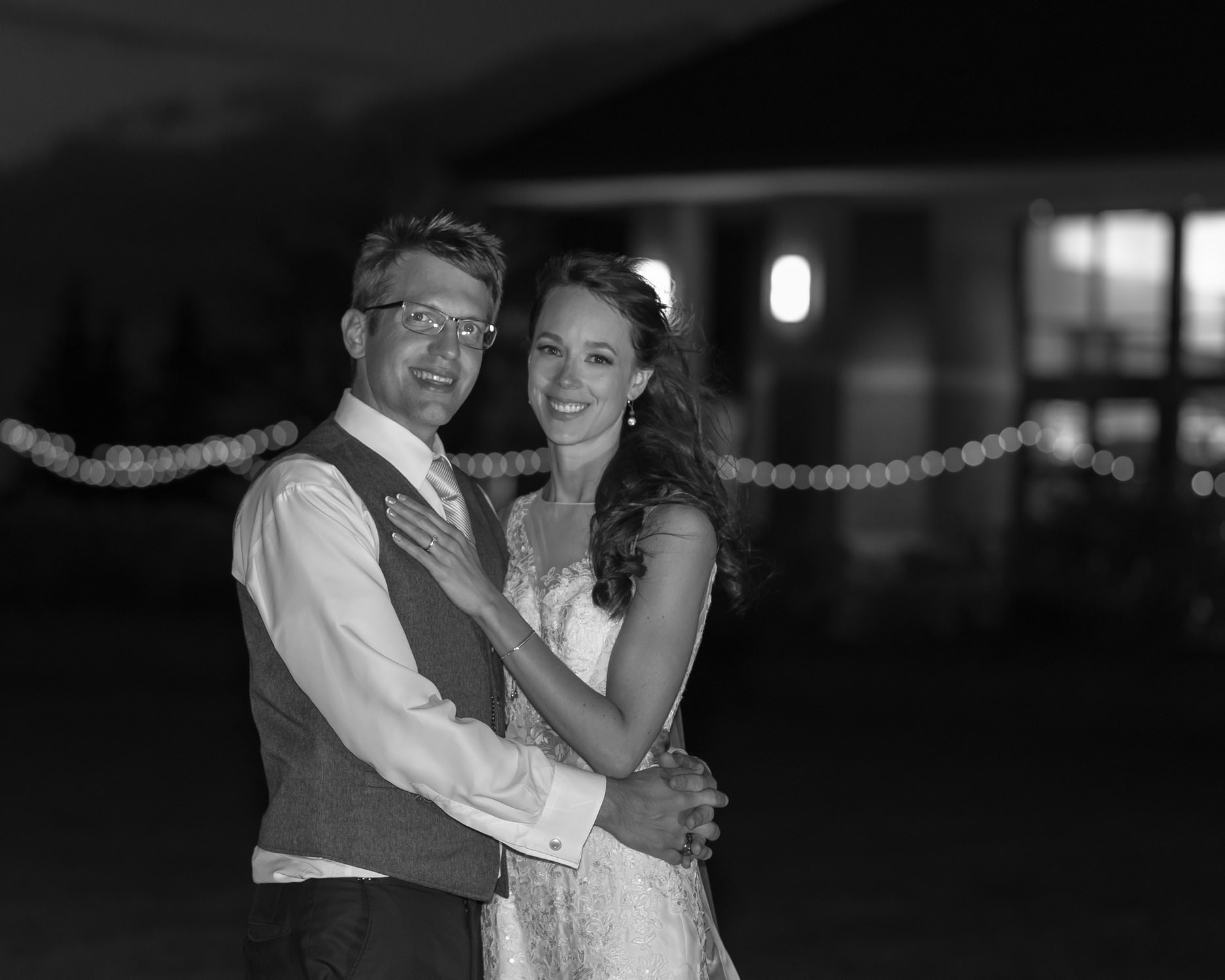 Bride And Groom Outside Reception With Lights