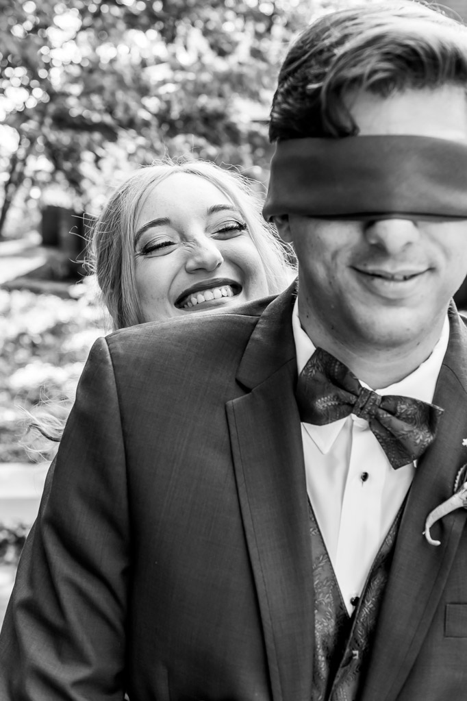 Bride's Playful Smile During First Look