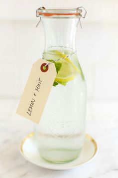 The mint adds some natural sweetness – so no sugar required! You'll Need 4 sliced lemons, 1 ½ packed fresh mint, 6 cups water, 6 cups ice cubes, Fresh mint for garnish. Directions In a large pitcher, place lemon slices. Bruise the mint leaves slightly by rubbing between the palms of your hands and then add to the pitcher. Pour in water. Cover and chill for 1-8 hours. Strain the mixture (Hint: keep the lemon slices as garnish!). Pour, add garnish, and enjoy.