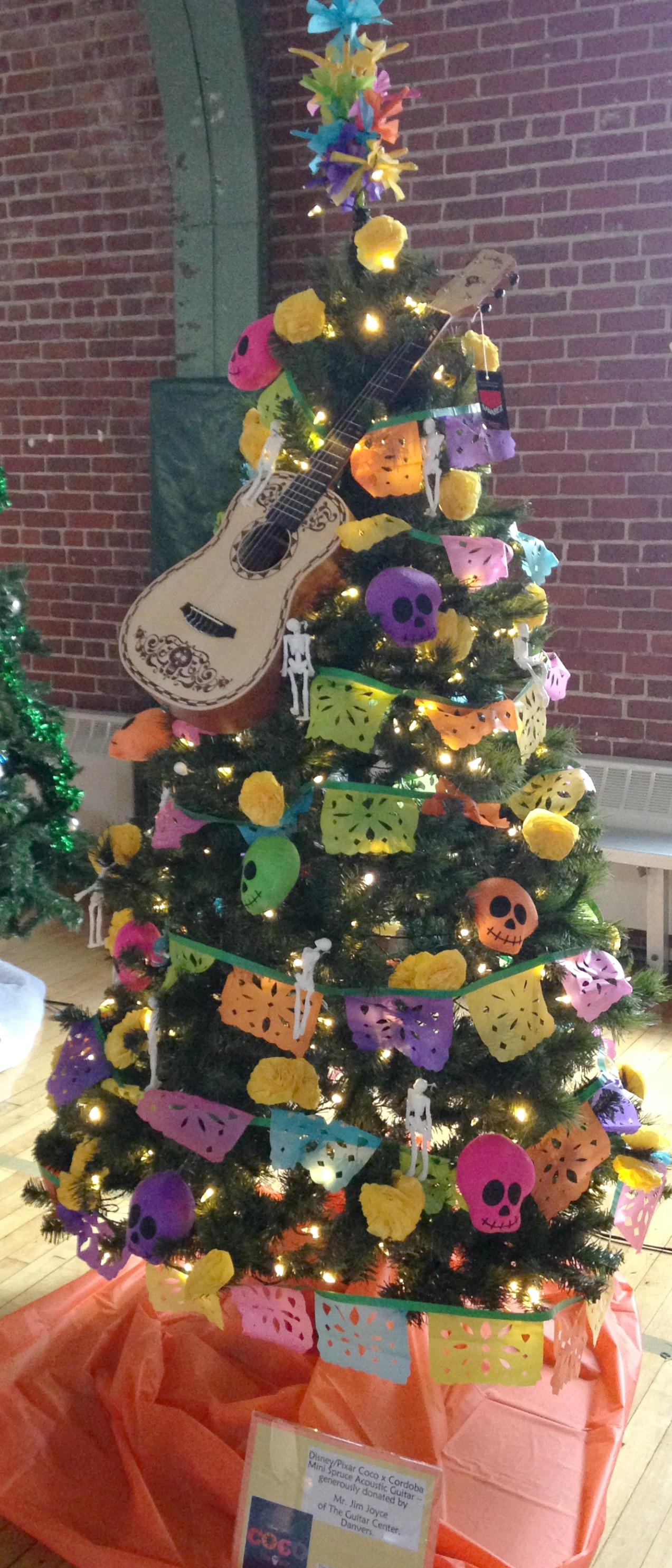 the stoneham chamber entered a disneypixar coco movie themed tree in the boys girls club of wakefield and stonehams 3rd annual festival of trees