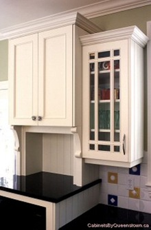 kitchen cabinet crown molding kidcraft uptown mouldings on varying heights stonehaven life different height cabinets by queenstown