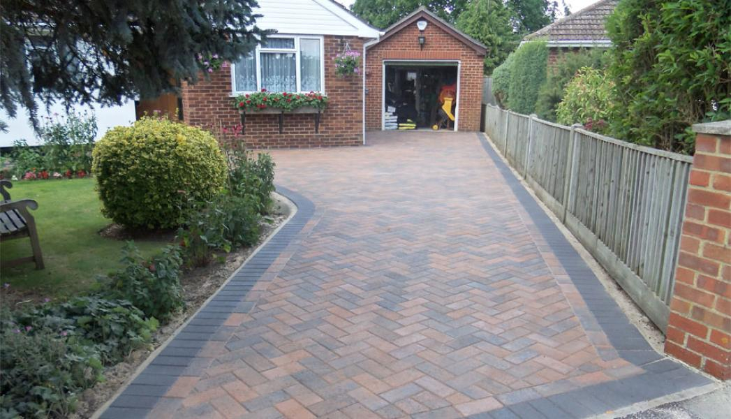 Pavers Driveway with Border alongside Garden
