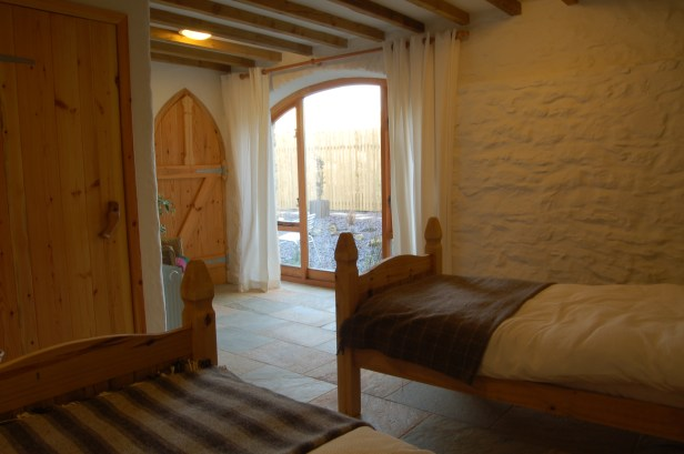 Pembrokeshire Holiday Cottages Harmony Barn - downstairs bedroom, a cosy eco holiday cottage.