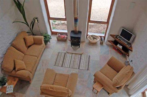 Harmony Holiday Cottage lounge with log burner