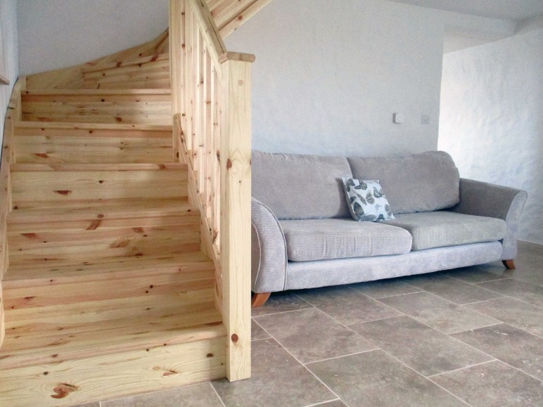 Pine FSC stair case and four seater sofa.