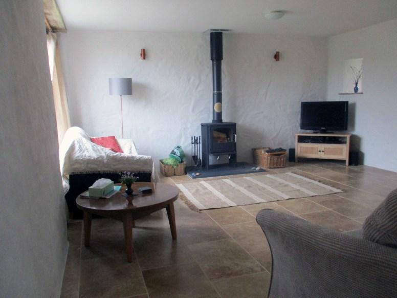 The spacious lounge with log burner.