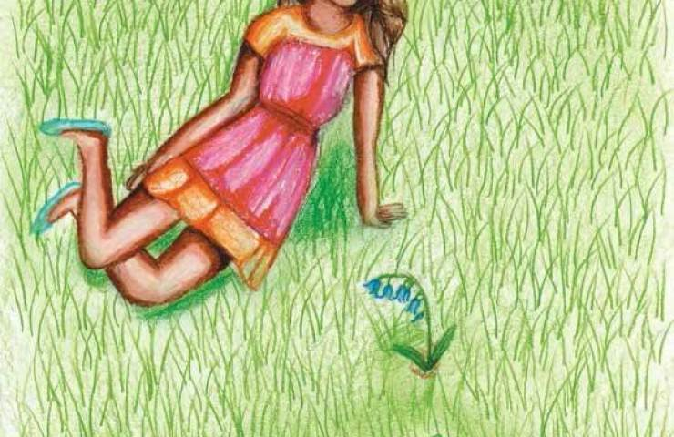 Blue Petals of Hope girl sitting on the grass